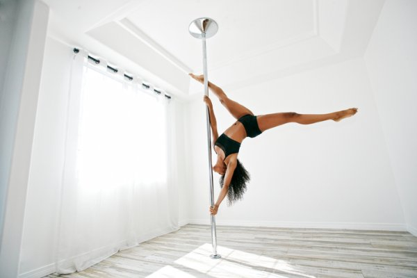 Woman exercising on pole