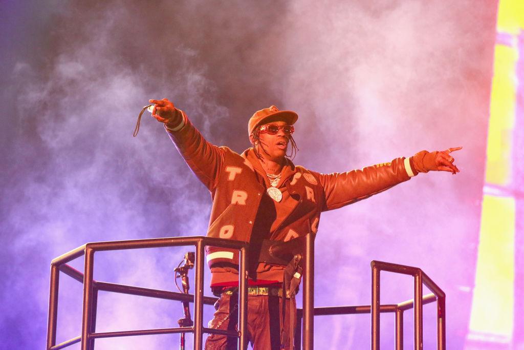Travis Scott Fans Bumrush Security Barricades At Dior Fashion Show In Paris [Video]