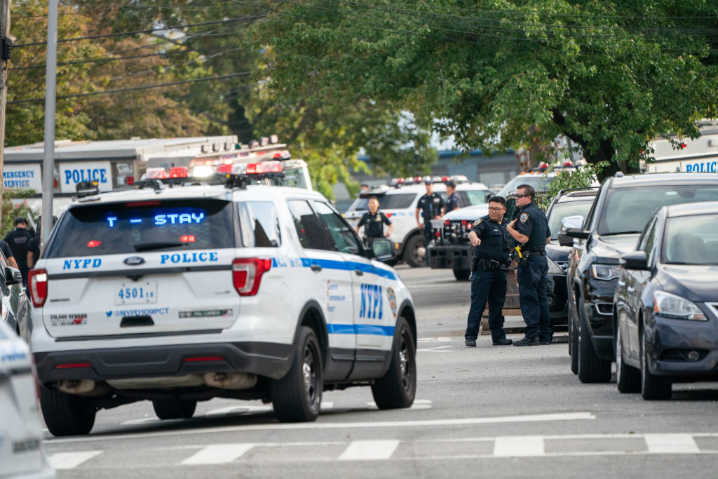 NYPD officers seen on the shooting scene. Police from 109th...