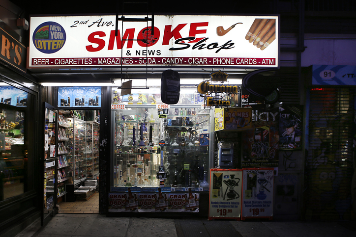 Tobacconist store in the East Village at night. New York City, USA