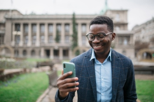 Young African American businessman using a smart phone