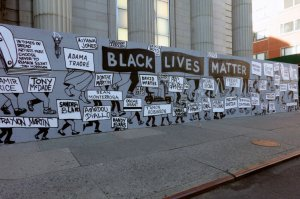 Black Lives Matter street sign depicting injustice and names of people killed by Police Brutality, New York City