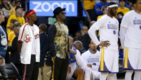 Musician Diddy, center, watches the Golden State Warriors game against the Cleveland Cavaliers next to the Warriors bench in the fourth quarter of Game 5 of the NBA Finals at Oracle Arena in Oakland, Calif., on Monday, June 12, 2017. (Nhat V. Meyer/Bay A
