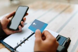 Man using credit card to pay bills