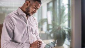 African-American businessman using a digital tablet