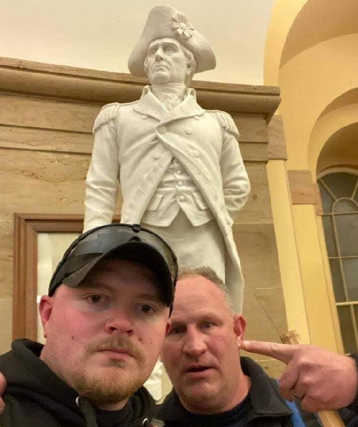 "officer Jacob Fracker, 29, and Sgt. Thomas ""T.J."" Robertson, 47,"