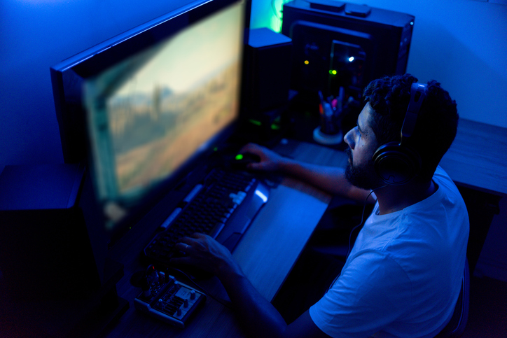 Man playing on the computer. Streamer, gamer.