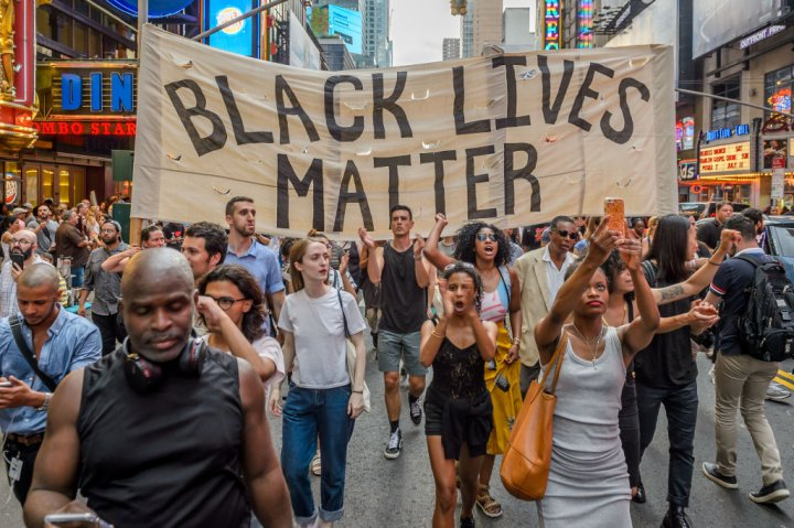 About two thousand New Yorkers marched in Manhattan bringing...