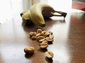 Peanuts and bananas on kitchen table