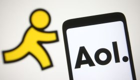 In this photo illustration, AOL logo is seen on a smartphone...