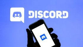 In this photo illustration a Discord logo in seen displayed...