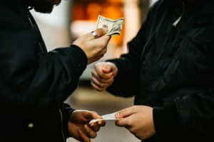 Man Buying Drugs On The Street