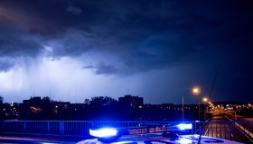 Spain, Madrid,Close-upof police emergency lights glowing during night intervention