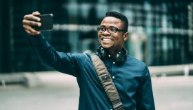 Joung afro ethnicity man taking selfie