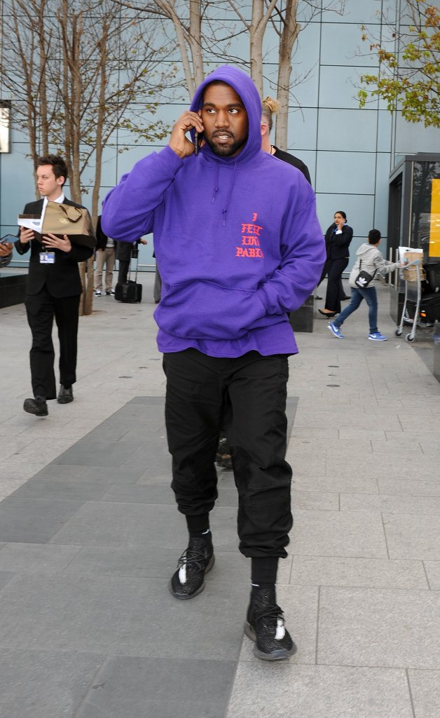 Kanye West arriving at Heathrow Airport all smiles