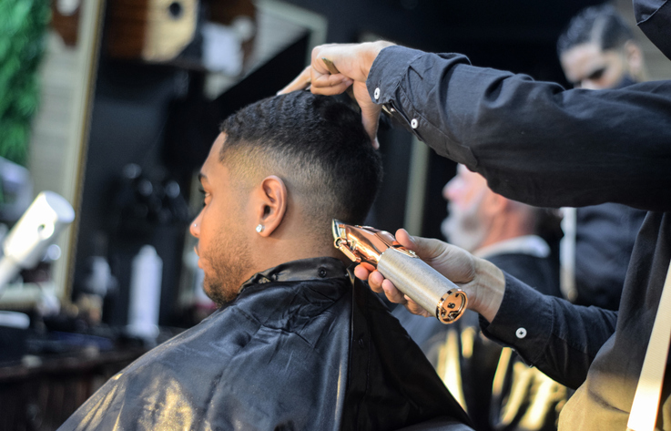 Young man having a haircut at a barbershop