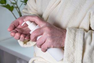 Senior man applying hand cream