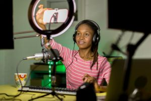 Young black woman recording a business podcast