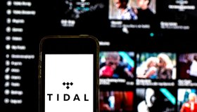 In this photo illustration a Tidal logo seen displayed on a...