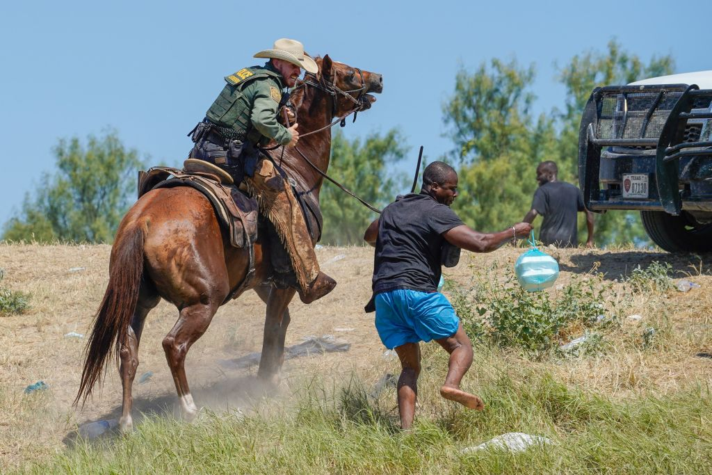 Photos of Border Patrol Agent Using Whips On Haitian Migrant Stokes Outrage