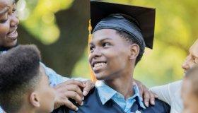 Proud teenage boy graduates from high school